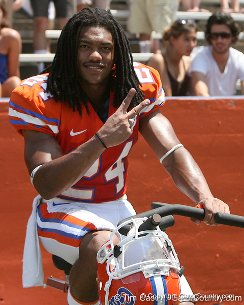 Florida junior free safety Josh Evans rides a stationary bike during the Gators' spring football game on Saturday, April 9, 2011 at Ben Hill Griffin Stadium in Gainesville, Fla. / Gator Country photo by Tim Casey