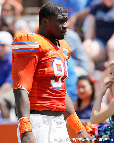 Florida redshirt junior defensive end Earl Okine walks to the locker room during the Gators' spring football game on Saturday, April 9, 2011 at Ben Hill Griffin Stadium in Gainesville, Fla. / Gator Country photo by Tim Casey