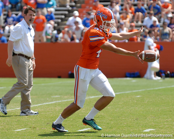 UF head coach Will Muschamp watches as freshman punter Kyle Christy punts during the 2011 Orange and Blue Debut at Ben Hill Griffin Stadium on Saturday, April 9, 2011. / Gator Country photo by Harrison Diamond