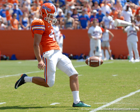 UF freshman punter Kyle Christy punts during the 2011 Orange and Blue Debut at Ben Hill Griffin Stadium on Saturday, April 9, 2011. / Gator Country photo by Harrison Diamond