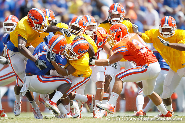Florida sophomore cornerback Cody Riggs tackles sophomore receiver Robert Clark after a 25-yard kickoff return during the Gators' spring football game on Saturday, April 9, 2011 at Ben Hill Griffin Stadium in Gainesville, Fla. / Gator Country photo by Tim Casey