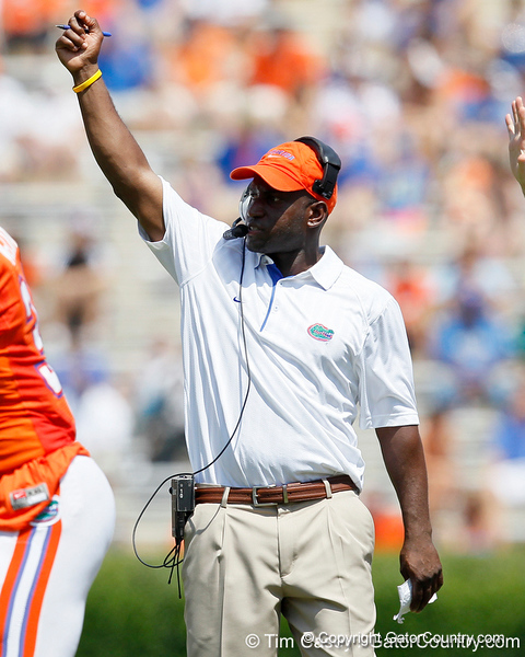 Florida defensive backs coach Travaris Robinson signals during the Gators' spring football game on Saturday, April 9, 2011 at Ben Hill Griffin Stadium in Gainesville, Fla. / Gator Country photo by Tim Casey