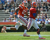 UF defensive end Chris Martin (23) chases quarterback Tyler Murphy as he rolls out of the pocket during the 2011 Orange and Blue Debut at Ben Hill Griffin Stadium on Saturday, April 9, 2011. / Gator Country photo by Harrison Diamond