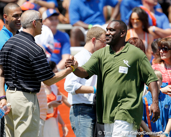 Florida athletics director Jeremy Foley shakes hands with former player Ricky Nattiel during the Gators' spring football game on Saturday, April 9, 2011 at Ben Hill Griffin Stadium in Gainesville, Fla. / Gator Country photo by Tim Casey