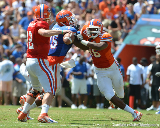 UF defensive end William Green tries to get past tackle Chaz Green while quarterback John Brantley throws during the 2011 Orange and Blue Debut at Ben Hill Griffin Stadium on Saturday, April 9, 2011. / Gator Country photo by Harrison Diamond
