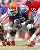 Florida redshirt sophomore guard Jonotthan Harrison prepares to snap the ball during the Gators' spring football game on Saturday, April 9, 2011 at Ben Hill Griffin Stadium in Gainesville, Fla. / Gator Country photo by Tim Casey