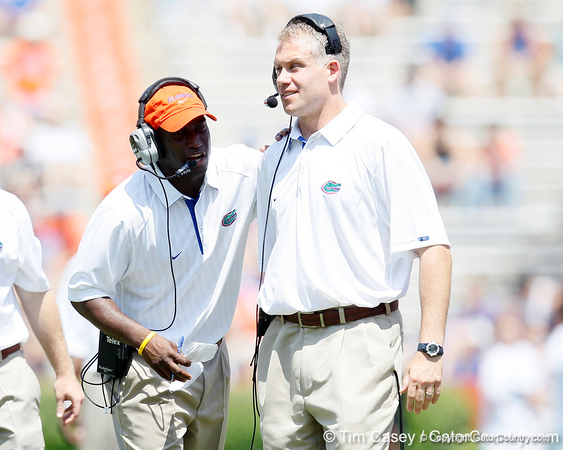 Florida defensive backs coach Travaris Robinson talks with linebackers coach/special teams coordinator D.J. Durkin during the Gators' spring football game on Saturday, April 9, 2011 at Ben Hill Griffin Stadium in Gainesville, Fla. / Gator Country photo by Tim Casey