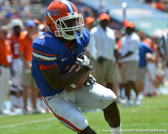 UF wide receiver Robert Clark catches a touchdown pass from quarterback Christian Provancha during the fourth quarter of the 2011 Orange and Blue Debut at Ben Hill Griffin Stadium on Saturday, April 9, 2011. / Gator Country photo by Harrison Diamond