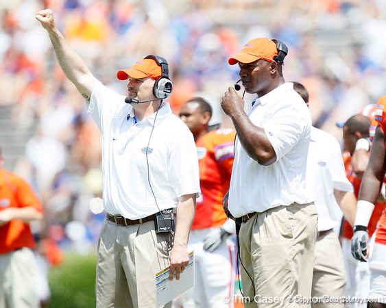 Florida defensive coordinator/defensive line coach Dan Quinn and defensive line coach Bryant Young signal to the field during the Gators' spring football game on Saturday, April 9, 2011 at Ben Hill Griffin Stadium in Gainesville, Fla. / Gator Country photo by Tim Casey