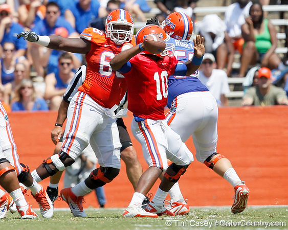 Florida freshman defensive tackle Leon Orr rushes redshirt freshman quarterback Tyler Murphy during the Gators' spring football game on Saturday, April 9, 2011 at Ben Hill Griffin Stadium in Gainesville, Fla. / Gator Country photo by Tim Casey