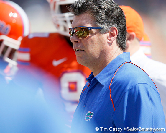 Florida offensive line coach/running game coordinator Frank Verducci conducts warmups before the Gators' spring football game on Saturday, April 9, 2011 at Ben Hill Griffin Stadium in Gainesville, Fla. / Gator Country photo by Tim Casey
