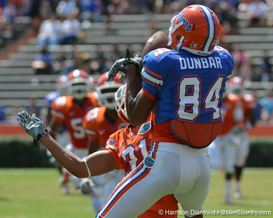 UF wide receiver Quinton Dunbar tries to haul in a deep ball from John Brantley while cornerback Cody Riggs tries to break it up during the 2011 Orange and Blue Debut at Ben Hill Griffin Stadium on Saturday, April 9, 2011. / Gator Country photo by Harrison Diamond