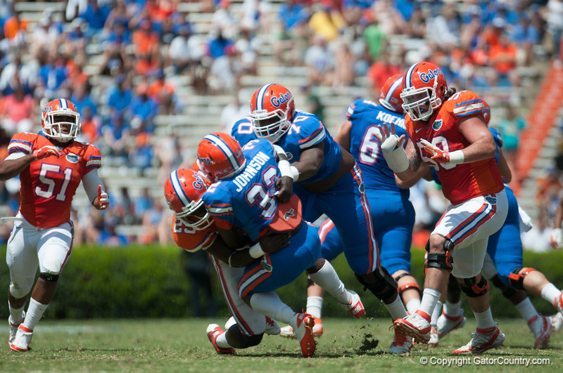Florida red shirt sophomore Gideon Ajagbe tackles Chris Johnson during the Gators' Orange and Blue Debut  on Saturday,  April 7, 2012 at the Ben Hill Griffin Stadium in Gainesville, Fla. / Gator Country photo by Saj Guevara