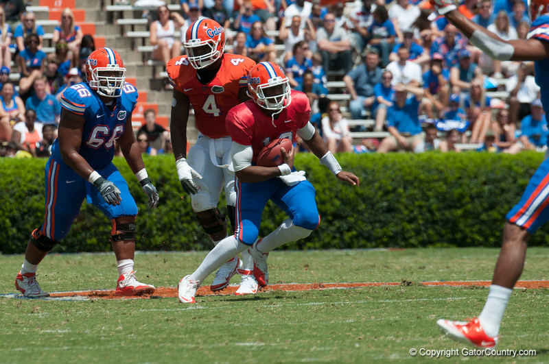 Florida sophore Jacoby Brissett rushing the ball  during the Gators' Orange and Blue Debut  on Saturday,  April 7, 2012 at the Ben Hill Griffin Stadium in Gainesville, Fla. / Gator Country photo by Saj Guevara