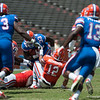 Florida red shirt sophomore Mack Brown is tackled during the Gators' Orange and Blue Debut  on Saturday,  April 7, 2012 at the Ben Hill Griffin Stadium in Gainesville, Fla. / Gator Country photo by Saj Guevara