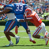 Florida freshman Antonio Morrison tackles Mack Brown during the Gators' Orange and Blue Debut  on Saturday,  April 7, 2012 at the Ben Hill Griffin Stadium in Gainesville, Fla. / Gator Country photo by Saj Guevara