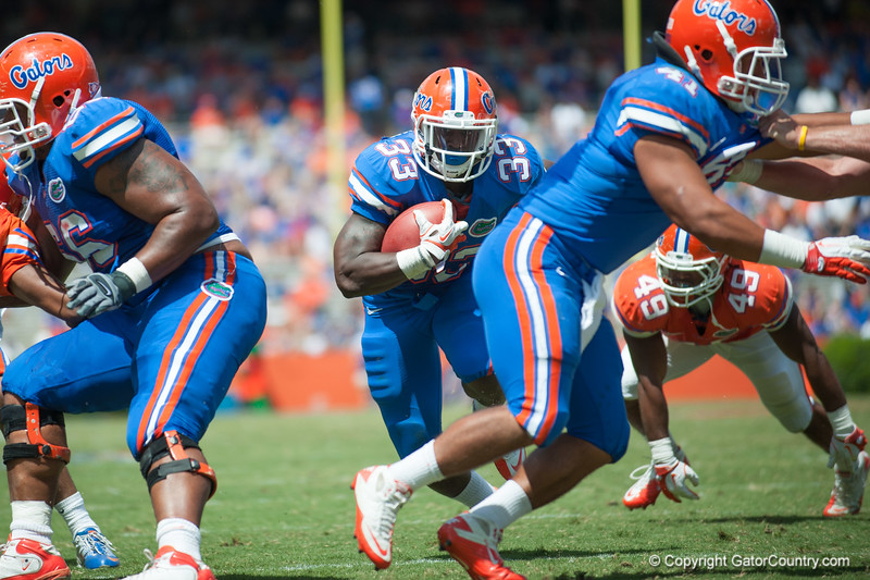 Florida red shirt sophomore Mack Brown rushes during the Gators' Orange and Blue Debut  on Saturday,  April 7, 2012 at the Ben Hill Griffin Stadium in Gainesville, Fla. / Gator Country photo by Saj Guevara