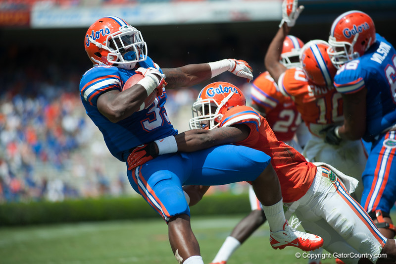 Florida red shirt sophomore Mack Brown is tackled for a touchdown during the Gators' Orange and Blue Debut  on Saturday,  April 7, 2012 at the Ben Hill Griffin Stadium in Gainesville, Fla. / Gator Country photo by Saj Guevara