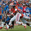 Florida senior Mike Gillislee is tackled during the Gators' Orange and Blue Debut  on Saturday,  April 7, 2012 at the Ben Hill Griffin Stadium in Gainesville, Fla. / Gator Country photo by Saj Guevara