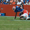 Florida red shirt sophore Quinton Dunbar  gets tackled by Jelani Jenkins during the Gators' Orange and Blue Debut  on Saturday,  April 7, 2012 at the Ben Hill Griffin Stadium in Gainesville, Fla. / Gator Country photo by Saj Guevara