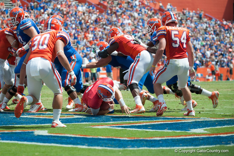 Florida sophomore Jeff Driskel rushes for a 1 yard touchdown  during the Gators' Orange and Blue Debut  on Saturday,  April 7, 2012 at the Ben Hill Griffin Stadium in Gainesville, Fla. / Gator Country photo by Saj Guevara