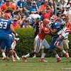 Florida junior Trey Burton is tackled during the Gators' Orange and Blue Debut  on Saturday,  April 7, 2012 at the Ben Hill Griffin Stadium in Gainesville, Fla. / Gator Country photo by Saj Guevara