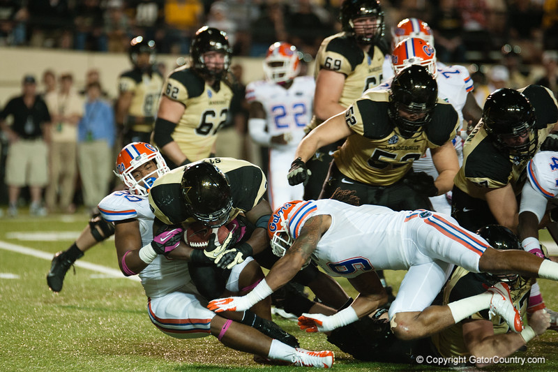 Florida freshman Jonothan Bullard (90) and Josh Evans (9) during the Gators' 31-17 win against the Vanderbilt Commodores Saturday October 13, 2012 at the Vanderbilt Stadium in Nashville, TN. / Gator Country photo by Saj Guevara