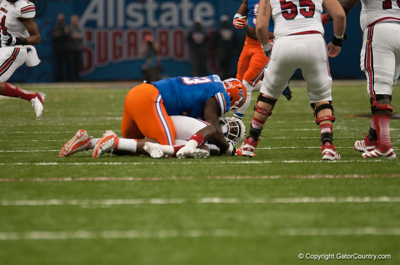 Florida  Sharrif Floyd   during the Gators' 33-23 loss against the Louisville Cardinals Wednesday January 2, 2013 at the Mercedes-Benz Superdome in New Orleans, LA. / Gator Country photo by Saj Guevara