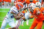 WR Solomon Patton tries to stiff arm DB Tracy Howard.  Gators vs Miami.  9-7-13