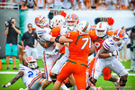QB Jeff Driskel takes a hard hit after trying to complete a pass. Gators vs Miami.  9-7-13.
