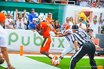Miami WR Herb Waters tiptoes the line for a Miami touchdown.  Gators vs Miami.  9-7-13