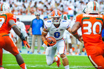 WR Trey Burton tries to juke a miami defender.  Gators vs Miami.  9-7-13.