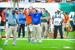 Coach Will Muschamp trying to get the play in.  Gators vs Miami.  9-7-13.
