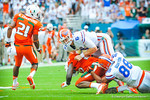 QB Jeff Driskel has to make the tackle after throwing his 2nd interception of the day.  Gators vs Miami.  9-7-13.