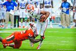 WR Quinton Dunbar gets tackled after making a catch.  Gators vs Miami.  9-7-13.