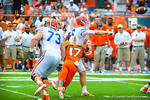 QB Jeff Driskel tjust gets the ball off.  Gators vs Miami.  9-07-13.