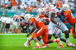 RB Mack Brown tries to jump through the hole.  Gators vs Miami.  9-07-13.