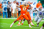 Miami QB Stephen Morris throws downfield.  Gators vs Miami.  9-07-13.