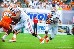 RB Mack Brown gets the handoff and runs downfield.  Gators vs Miami.  9-07-13.