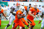 Miami RB Duke Johnson bounces to the outside.  Gators vs Miami.  9-07-13.