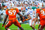 WR Trey Burton tries to cut back.  Gators vs Miami.  9-07-13.
