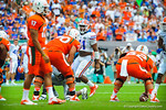 LB Michael Taylor awaits the snap of the ball.  Gators vs Miami.  9-07-13.
