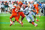 LB Ronald Powell tries to tackle QB Stephen Morris.  Gators vs Miami.  9-07-13.