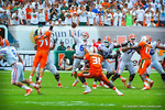 QB Jeff Driskel throws downfield.  Gators vs Miami.  9-07-13.