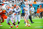 QB Jeff Driskel looks for an open receiver.  Gators vs Miami.  9-07-13.