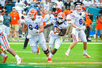 RB Matt Jones takes the handoff and runs to the outside edge.  Gators vs Miami.  9-07-13.