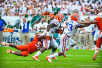 RB Mack Brown runs and is tackled.  Gators vs Miami.  9-07-13.