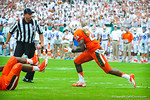 Miami DB Rayshawn Jenkins runs upfield after catching the Driskel interception.  Gators vs Miami.  9-07-13.