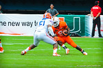 Miami RB Duke Johnson tries to elude LB Michael Taylor.  Gators vs Miami.  9-07-13.