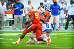 WR Trey Burton is hit after making the catch.  Gators vs Miami.  9-07-13.